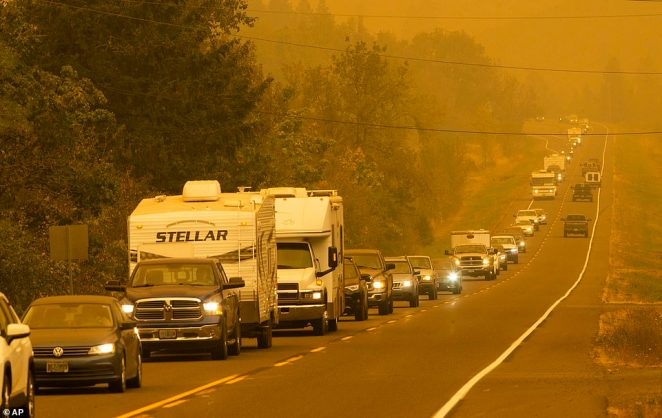 A steady stream of vehicles heads west on a road east of Springfield, Oregon