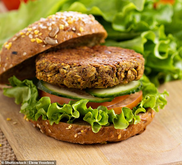 The popularity of plant-based burgers have soared in recent years as more people avoid animal products for environment, health, and animal welfare benefits. Pictured: A vegan burger with lentils and pistachios (stock)