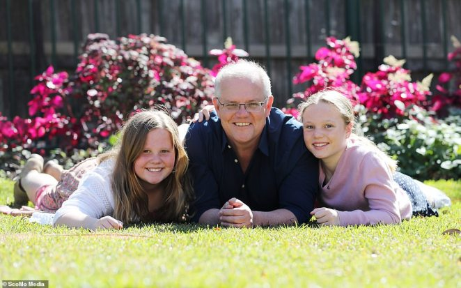 Prime Minister Scott Morrison is pictured with his two daughters Abbey and Lily in the garden of Kirribili House in Sydney