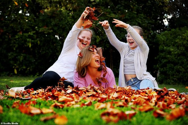 Mrs Morrison (pictured with her daughters) said she booked her mammogram straight after filming the video.'So call the doctor. Book that appointment. Because your health is so important to you and those around you,' she said