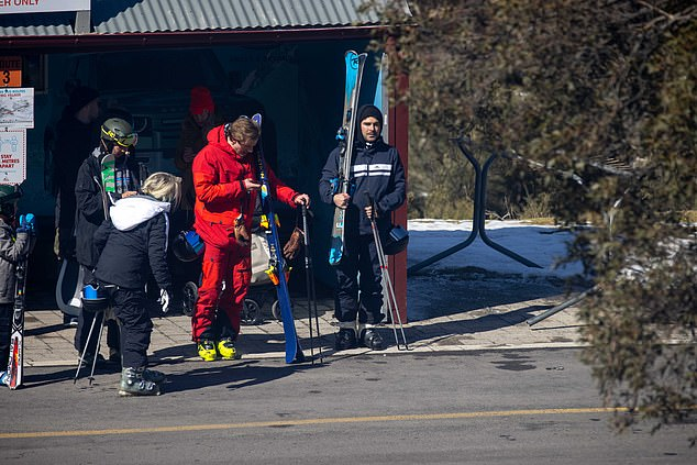 Activities: Zac looked excited as he held onto the skis and poles at the hire shop