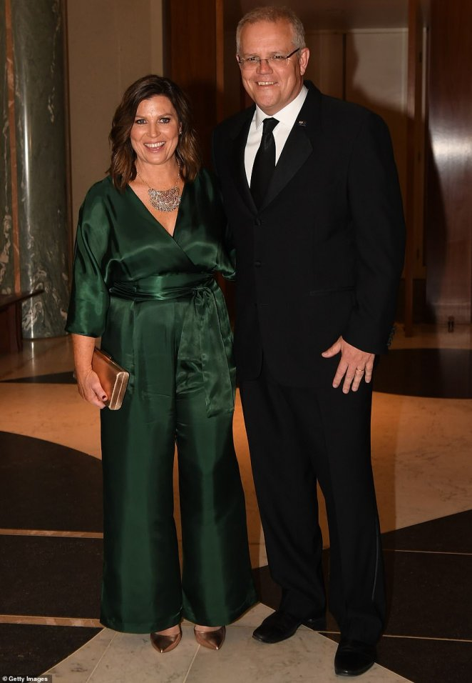 Mrs Morrison looked radiant in an emerald green jumpsuit at the Midwinter Ball on Wednesday night in Canberra. Mrs Morrison chose the Ginger & Smart's Sonorous outfit, which retails for $650