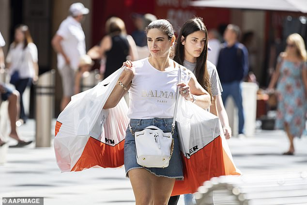 Shoppers pictured in Melbourne in 2018. NAB's StraightUp Card doesn't charge interest or foreign currency fees