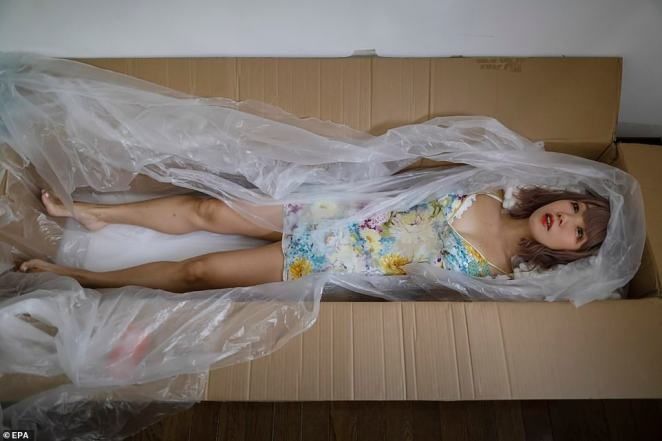 Ai Kaneko is 'packaged' into a product box for a shipment, after being transformed into a sex doll at the Human Love Doll Factory