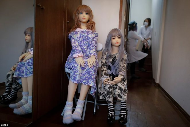 Sex dolls named Sayaka (left) and Rinne (right) sit and welcome visitors at the entrance of the bizarre Japanese studio