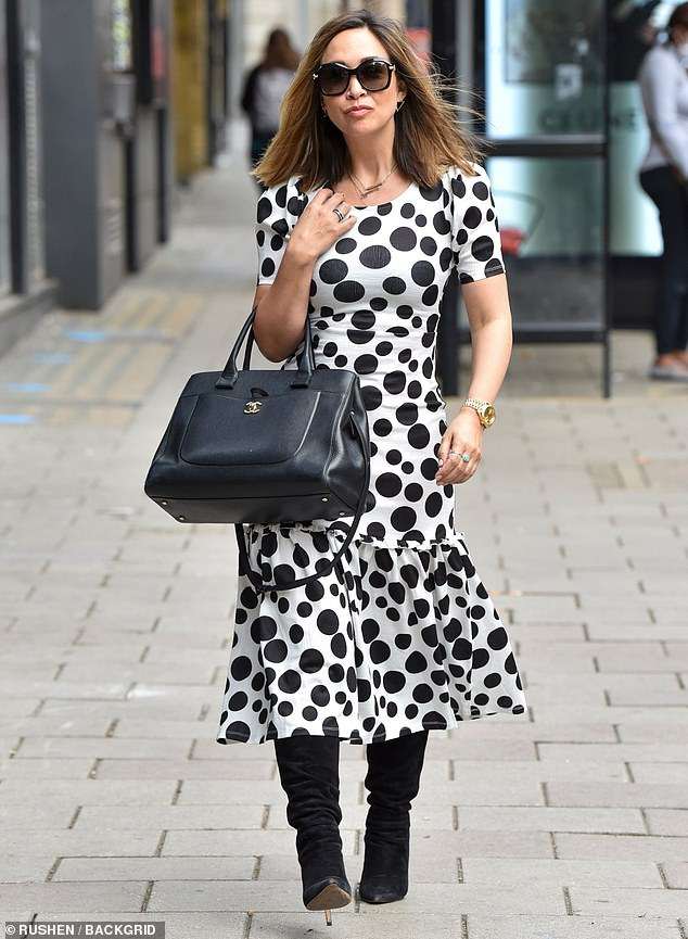 Myleene Klass catches the eye in a black and white polka dot dress and boots as she heads to work