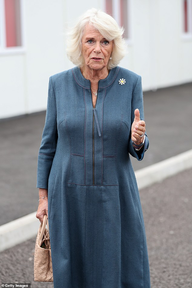 TheDuchess of Cornwall wore her blonde locks in a classic polished style and teamed her dress with dainty jewellery and a pair of pearl earrings
