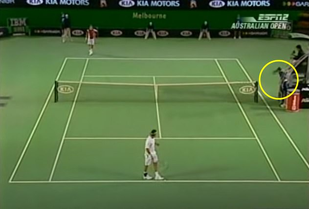 Federer swung his racket from behind before hitting the ball boy (circled in yellow)