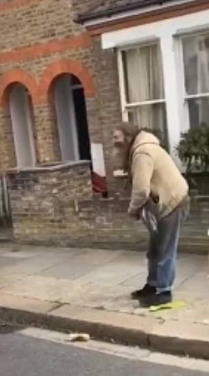 The man is hit by the taser gun and begins to fall