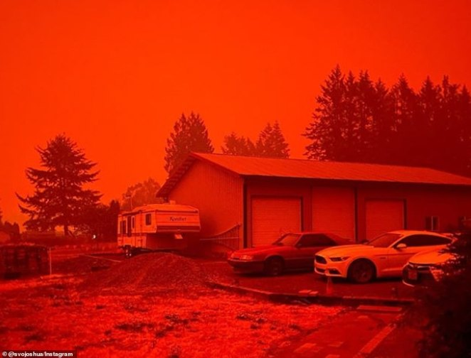 A frightening red haze has been cast over towns in Oregon as 35 wildfires rage around the state