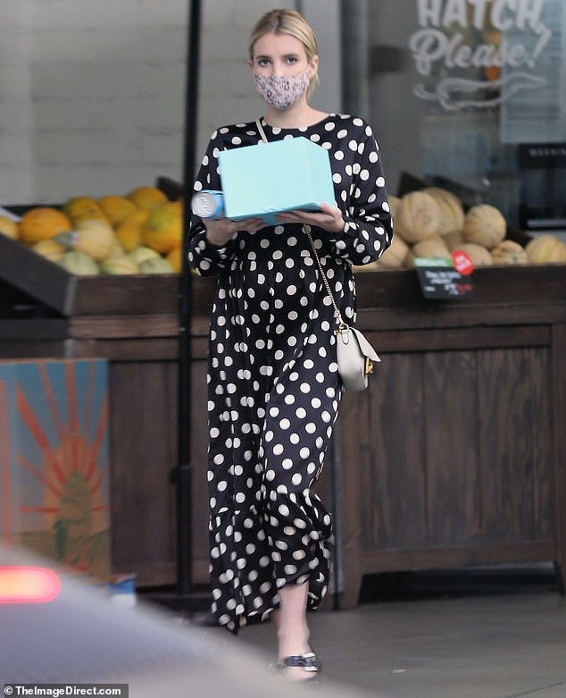 Polka dots: The Hollywood vet cut a feminine figure in a long flowing polka dot dress as she grabbed groceries in style