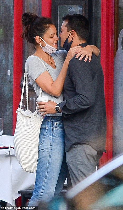 For the romantic embrace, Katie was dressed casually in light blue jeans and a tight-fitting grey top, while Emilio went simple in a pair of dark jeans and a navy shirt.