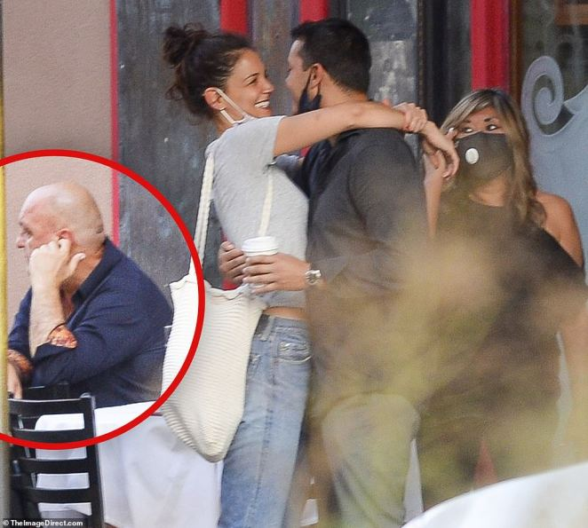 Don't look dad! Emilio's father, restaurateur Emilio Vitolo, appeared to be averting his eyes as he sat to the left of the new couple