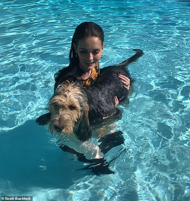 Fun in the sun: At one point, Lydia brought her beloved dog into the water with her