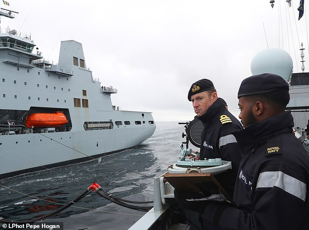 Crew members of HMS Sutherland help conduct RSA while operating with USS Ross and RFA Tidespring in Northern Waters