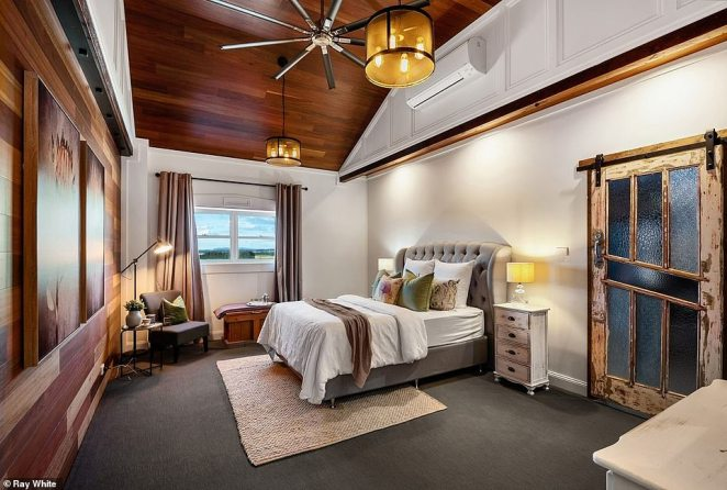 Hints of the building's rustic past remain, like timber panels and distressed farmhouse doors leading into the bedrooms