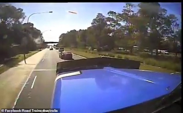 A woman who merged in front of truck on a busy Sydney road filed an insurance claim within an hour claiming she was not at fault after the incident (pictured)