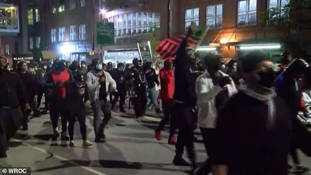 Protesters waved flags, made speeches, and chanted for justice for Prude