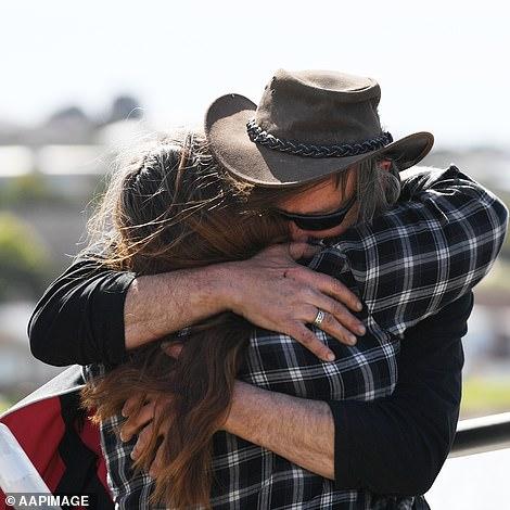 Mr Robinson hugging a family member