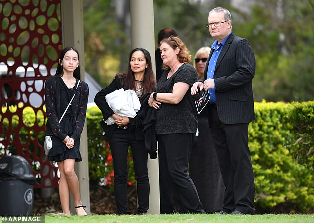 Ms Caisip's mother (second left) and sister (left) attended the funeral without her there as she was banned from mingling with her family