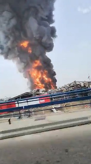 A huge column of black smoke and red leaping flames were seen among the steel wreckage this afternoon. It is not yet clear what may have caused the fire.