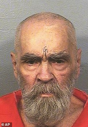 Maxwell's case was compared by lawyers to that of notorious cult leader and killer Charles Manson (pictured in prison months before he died in 2017)