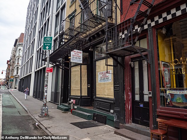 New York City is currently facing a $8 billion budget deficit, which is expected to grow in the coming years. The COVID-19 pandemic has devastated the city's economy with businesses forced to shut down. Pictured above is shuttered stores in Manhattan's SoHo neighborhood