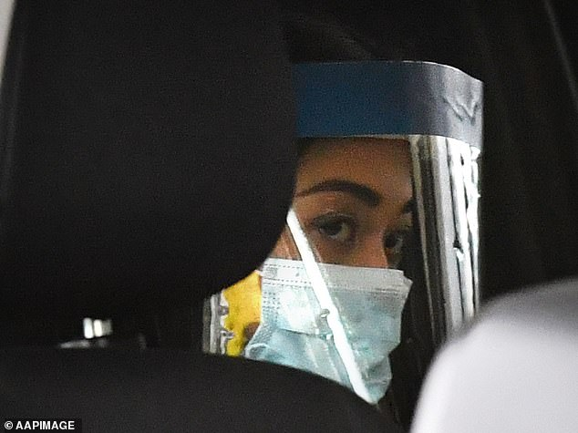 Ms Caisip is seen wearing a face mask and protective shield as she leaves her father Bernard's service in Brisbane on Thursday