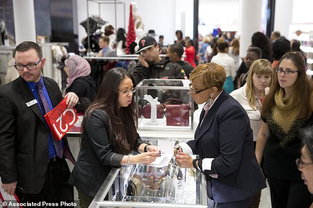 Century 21 Stores has filed for Chapter 11 bankruptcy and is winding down its business, including all 13 stores across New York, New Jersey, Pennsylvania and Florida. Pictured, people shop at the Century 21 Department Store in Philadelphia