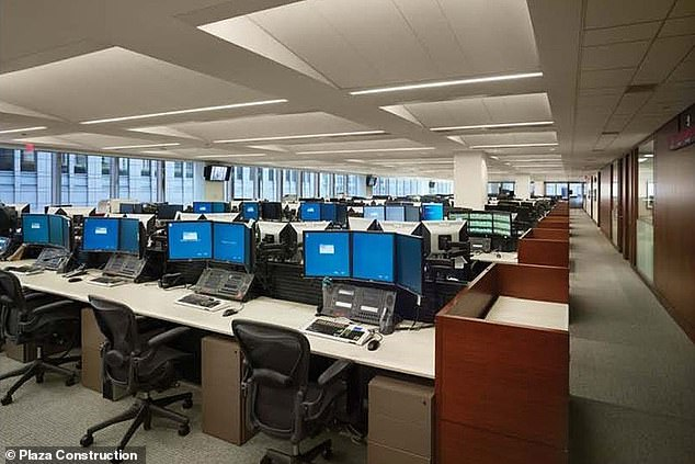 JP Morgan's trading floor is seen above in a file photo. When the pandemic struck New York with force in mid-March, many employers were forced to hastily implement remote-working