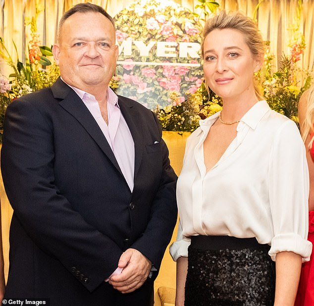 Myer chief executice John King (pictured with actress Asher Keddie in 2019) has slammed Daniel Andrews' roadmap out of lockdown