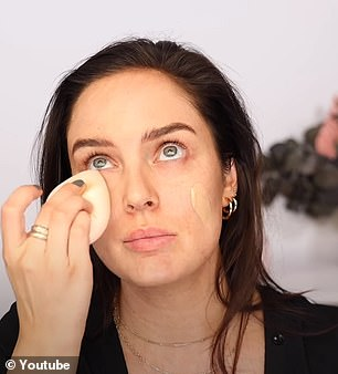 After moisturising her skin, Chloe starts by applying foundation with a beauty sponge