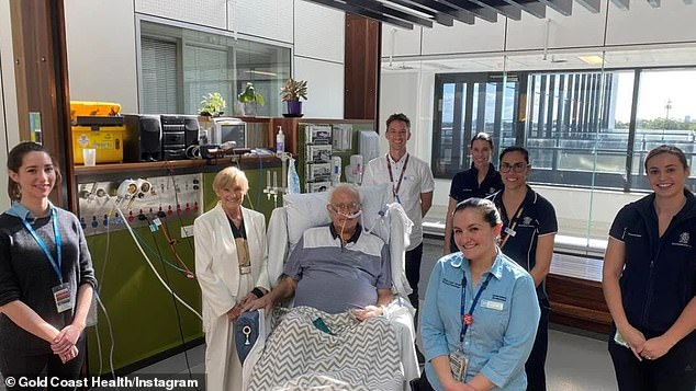 81-year-old Richard (pictured, centre) bravely battled COVID-19 in ICU at the Gold Coast University Hospital in Queensland for 77 days