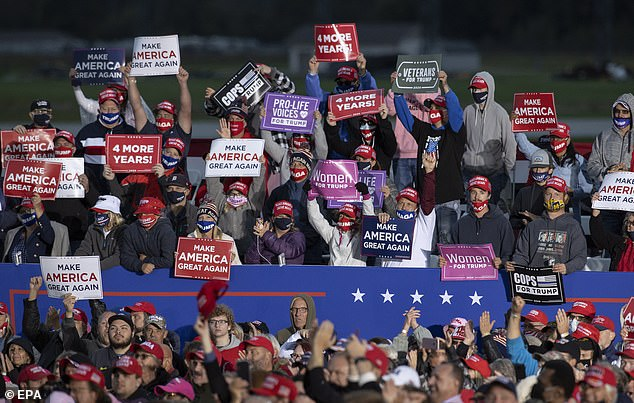 'On November 3 Michigan you better vote for me! I got you so many damn car plants,' Trump said as the crowd cheered while waving 'Make America Great Again' signs