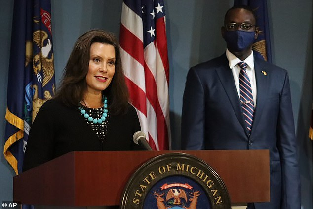 """Michigan Gov. Gretchen Whitmer sharply criticized President Donald Trump following revelations that he had purposely downpla yed the deadly coronavirus, calling it """"devastating"""" news and Trump the """"biggest threat"""" to Americans"""