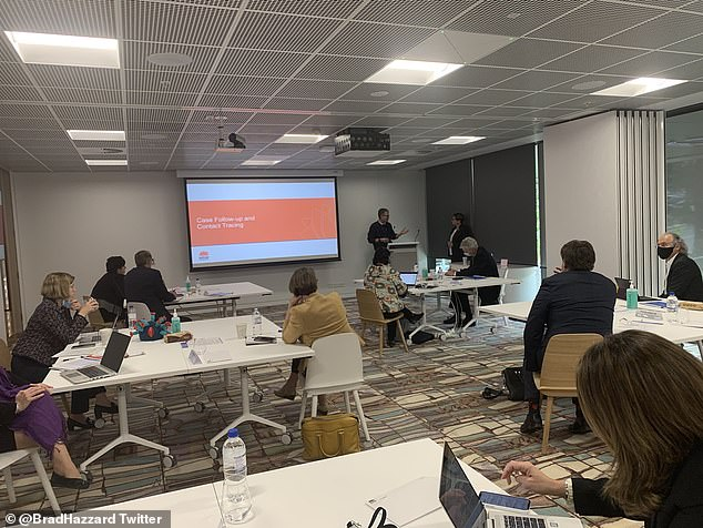 Victorian health officials went back to class in Sydney on Friday to learn how to contact trace as the state prepares to relax coronavirus restrictions. The board reads 'case follow-up and contact tracing'