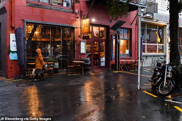 The Westpac bank is expecting Thursday's official figures to show an 11.5 per cent contraction for the June quarter - a level significantly more severe than Australia's record seven per cent plummet during the same period. Pictured is a restaurant in Wellington in June