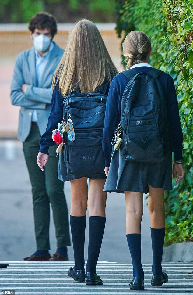 Leonor, left, and Sofia, right, both have trendy keyrings attached to their schoolbags, just like any other pupils