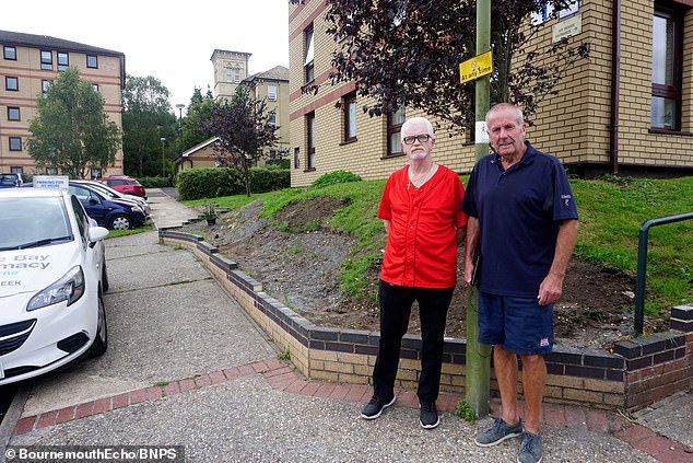 Neighbours John Supron and Neil Logan pictured in front of the bare earth after they ordered byBournemouth Christchurch and Poole (BCP) Council to remove the rockery