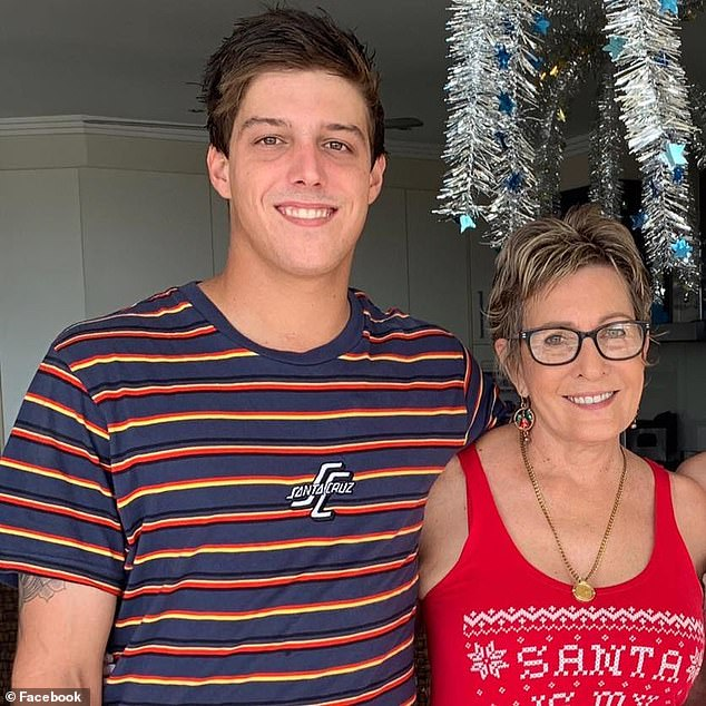 Sheryl Mulvey, of Victoria, applied for a border exemption and travelled to Townsville to attend 24-year-old Gage Hepburn's funeral after he suddenly died on August 31. Pictured: Ms Mulvery with her eldest grandson, MrHepburn
