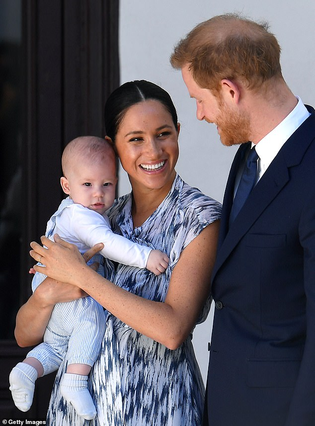 Meghan Markle and Prince Harry's video calls are often interrupted by their son Archie who 'climbs in front of the web camera and makes little impromptu cameos', their biographer has claimed. Pictured, the family in September 2019