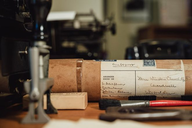 A postal tube, desk stamp and stationery in the secretaries' office.Items on display in the country house also include a typewriter, telephone, inkwell, address bookand even a map case given to Churchill by President Roosevelt