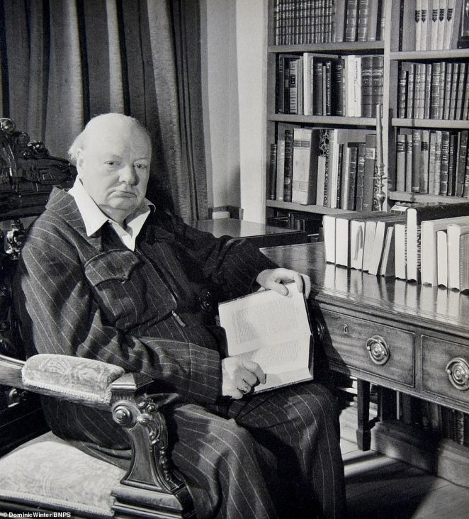 Pictures also show him Churchill sat inside his library and walking around the grounds of his home near Westerham, Kent