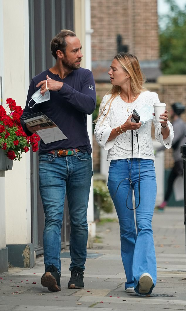 Striding ahead: The couple chatted as they left the £895,000 property after the viewing