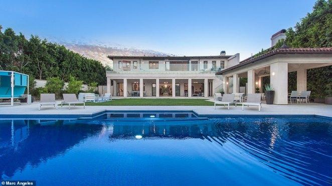 The expansive backyard has an impressive pavilion, lounge space and a massive 25,000-gallon infinity edge pool