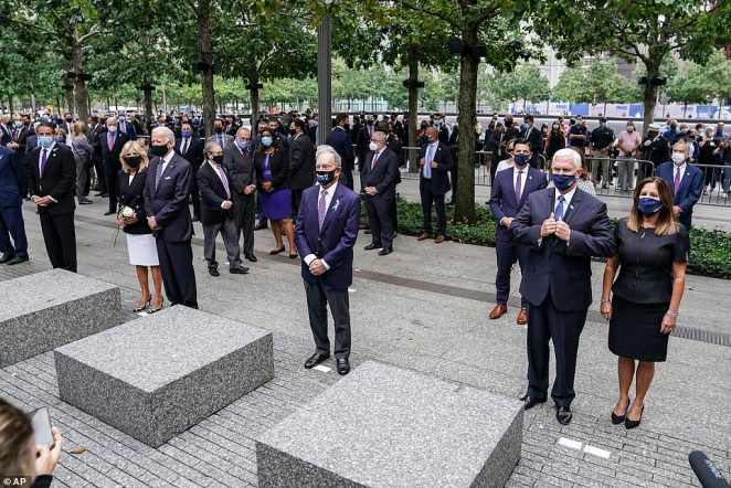 From left, New York Gov. Andrew Cuomo, Democratic presidential candidate and former Vice President Joe Biden, former New York Mayor Mike Bloomberg, and Vice President Mike Pence stand during the national anthem at the National September 11 Memorial and Museum, Friday, Sept. 11, 2020, in New York