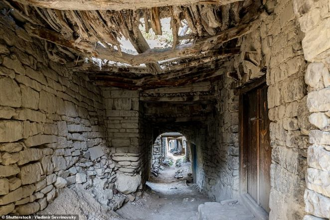 Eerie corridors and walkways are still intact in Koroda, with some of the wooden doors also in place and firmly shut