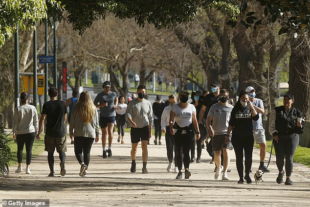 Victoria has recorded just 43 new cases of coronavirus and nine more deaths on Friday (people exercise along the Tan track in Melbourne pictured)