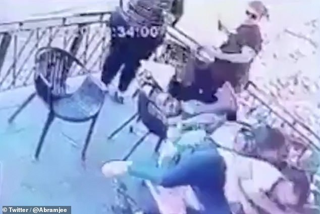 The mother was dragged across the table by the attacker as she desperately clung to her child