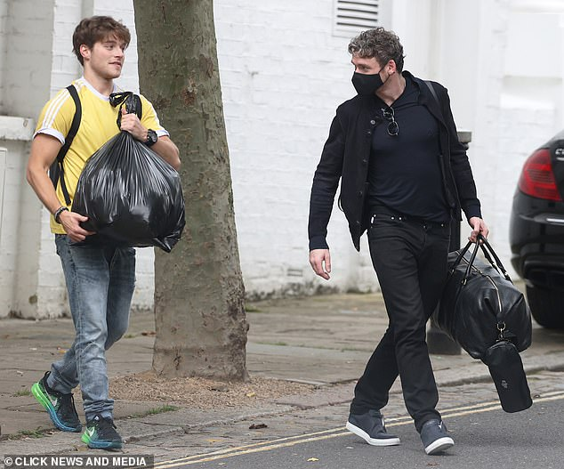 On British soil:Richard Madden was spotted back in London as he took out the bins with actor pal Froy Gutierrez on Thursday